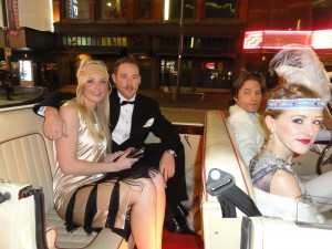 Group poses in great gatsby Vancouver Limo