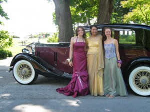 Girls pose before promo next to Vancouver Classic Limo