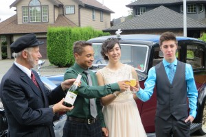 Grads pose by classic Vancouver Limo