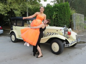 Mom lifts daughter in air before prom by Vancouver Classic White Limo