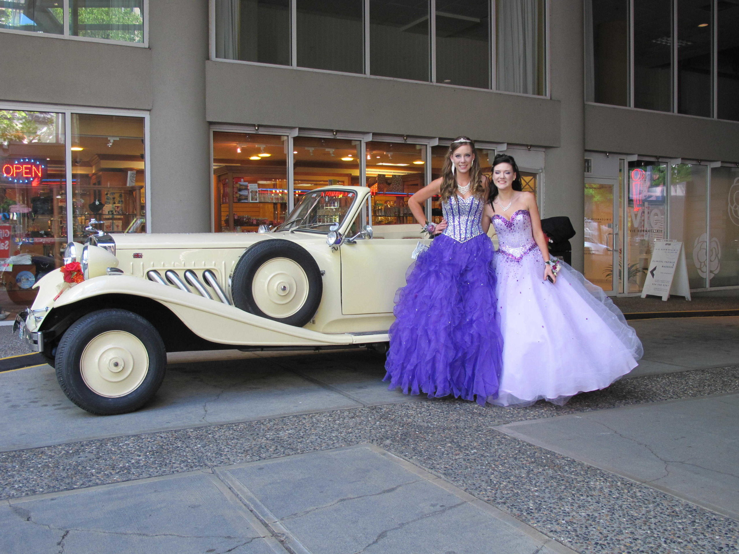 Girls pose before promo next to Vancouver Classic White Convertible Limo