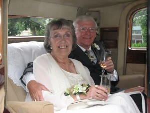 Couple poses for Wedding Anniversay in Classic Vancouver Limo